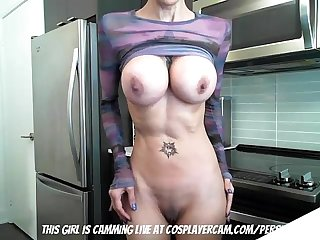 Persian milf fucking herself in the kitchen