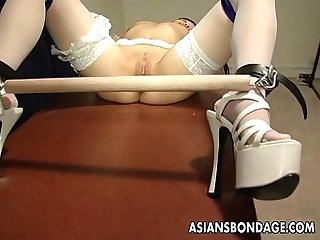 Voluptuous domina toy teasing the bound asian slut
