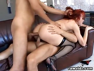 Redhead milf takes care of two Hunks big cocks