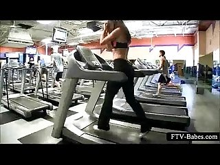 Sexy sporty girl teasing boobs while working out
