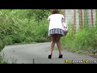 Kinky asian teen peeing