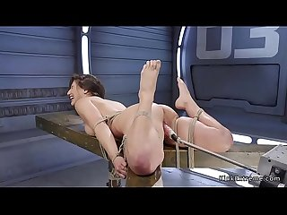 Tied up brunette gets fucking machine