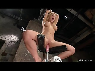 Tied busty squirter is machine fucked