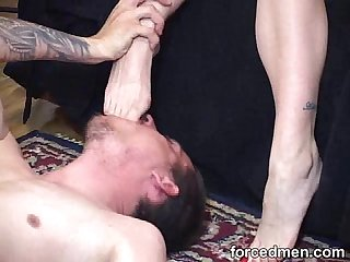 Naked man licks and worships his tired mistress feet