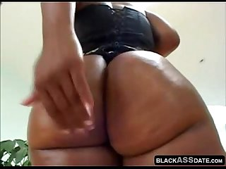 Cluse up on big oily ebony butt