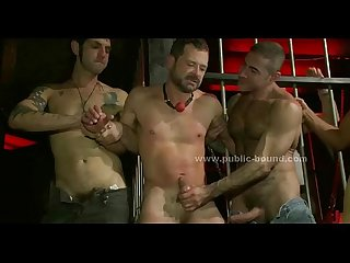 Tied Sexy hunk brought to order by horde of strong Gay men