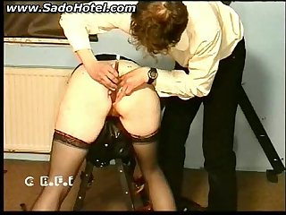 Slave gets fucked with a candlestick and spanked on her ass bdsm