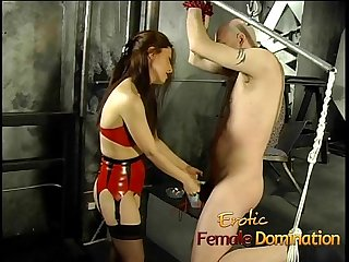 Tied up and gagged stud has his cock pleasured by an asian bimbo