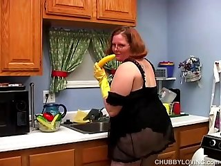 Hot and horny chubby housewife has a nice wank in the kitchen