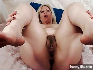 Blonde milf with natural big tits and big ass strokes her hairy pussy on cam for honeytits com