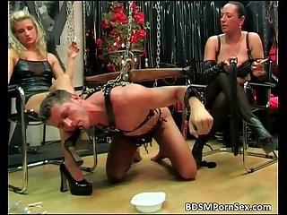 Male slave is tied in chains in this