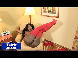 Curvy black tranny playing with her cock