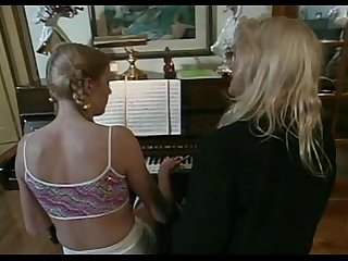 Older piano teacher seduces young teen student