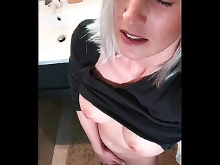 Hot blonde fingers secretly in the bathroom to orgasm
