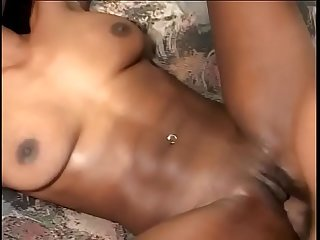 Black slut with tattooed ass cheeks gets her pussy pounded by a big dong