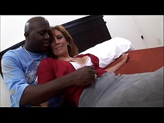 Amateur mature milf taking a big black cock in interracial video