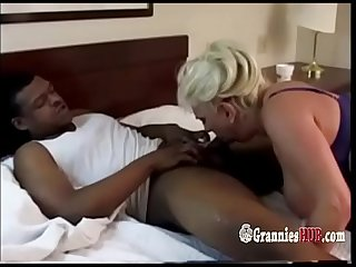 Busty bbw blonde granny sucks big black cock