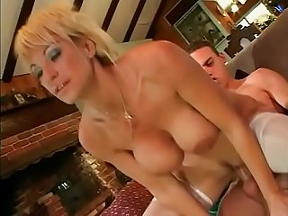 Blondie short haired milf with A pair of enormous boobs