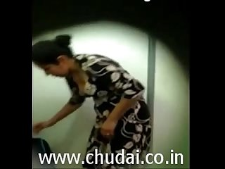 Desi Indian Bhabhi changing dress captured by devar