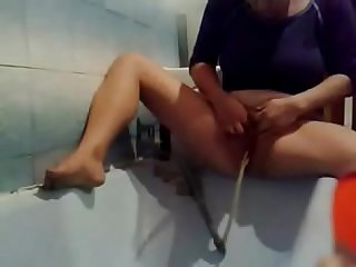Caught my mom using bottle to masturbate. Hidden cam