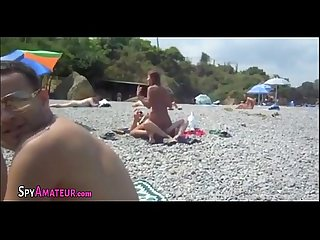 Fucking at the middle of the beach on spy cam on spyamateur com