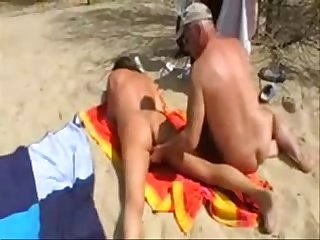 My slut mature bitch used by strangers at nude beach. Amateur home made