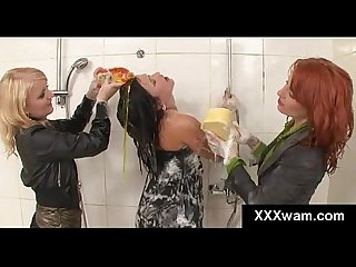 Lathered up lesbian hotties bathe their smoking hot lover