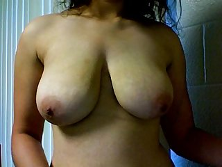 Girl plays with her big natural tits