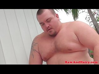 Superchub bear barebacks outdoors before cum