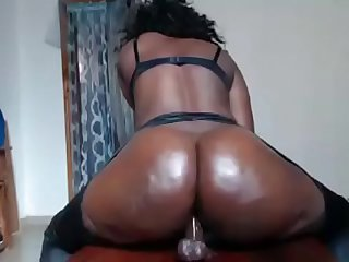 Black girl rides dildo
