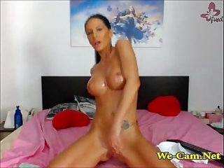 Horny brunette striptease riding with dildo