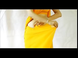 Sexy teen wearing saree and showing her boobs and assets