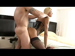 Blonde shemale in sexy black stockings fucked doggystyle