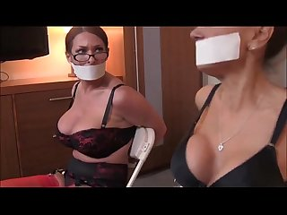 Two milfs chair bound and tape gagged