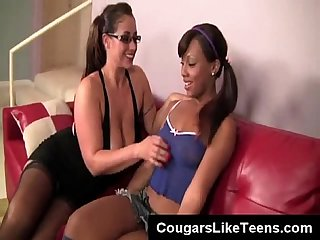 Horny as hell cougar with huge tits seduces a black little teen slut