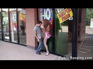 Pretty teen girl having sex in public by a store window