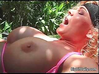 Curly blonde vixen with big tits sucks