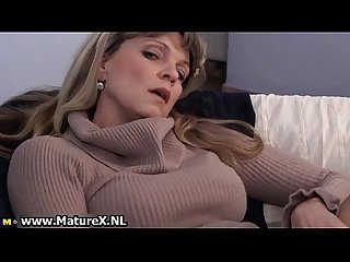 Older mature woman enjoys laying