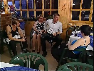 Chubby mature slut rides and sucks two young cocks in A bar