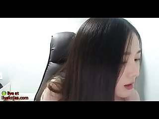 Korean beauty plays with her round tits