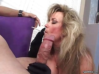 Sexy blonde mature smokes and sucks cock