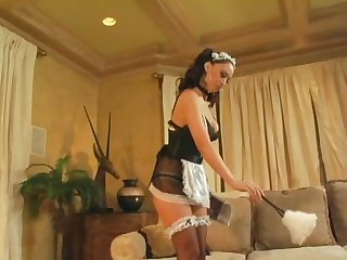Busty maid teases in uniform and stockings
