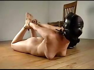 Ballgagged girl gets hooded and chained comma hogtied on the ground with no escape