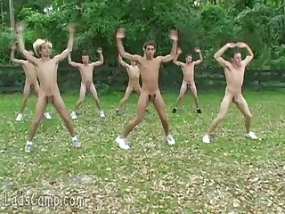 Several twinks exercise all naked by the campsite