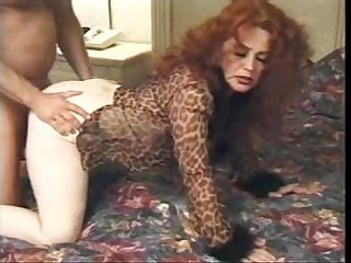 Redhead granny takes it in the ass