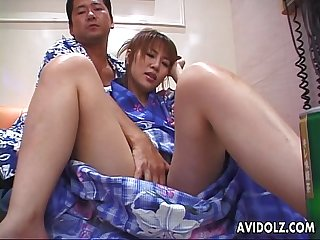 Kimono wearing Asian brunette plays with her toy