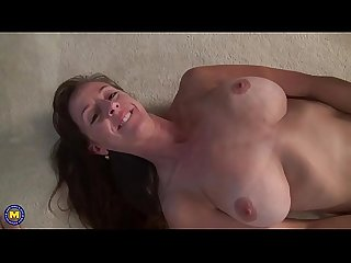 Busty mature lady masturbating