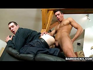 Two muscular studs in fancy clothes have bareback anal