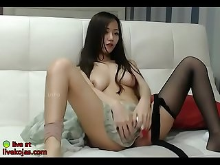 Busty Korean camgirl masturbates in pantyhose