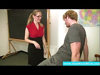 Mature teacher blows her student